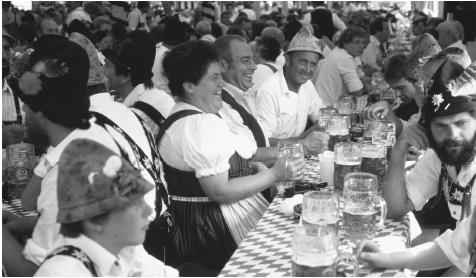 German people at a long table at oktoberfest